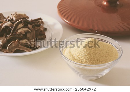 Corn flour, porcini and a good tomato this is all you need for a great plat: polenta with mushrooms sauce - stock photo