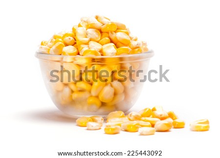 Corn kernels in glass bowl isolated on white background - stock photo