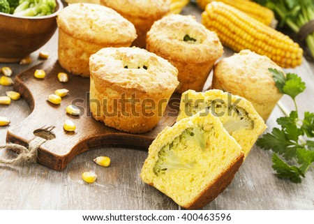 Corn muffins with broccoli on the table - stock photo