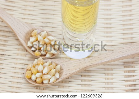 Corn seed with corn oil on a bamboo basket - stock photo