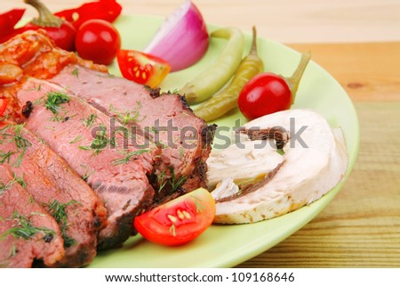 corned beef on plate over wooden table