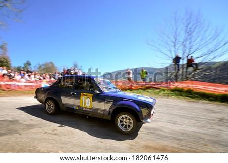 CORNELLANA, SAPIN - MAR 8: Spanish driver Jonatan Alvarez and his codriver Juan Bravo in a Ford Escort RS2000 Mk I race in the 6th Solo Escort, on Mar 8, 2014 in Asturias, Spain. - stock photo