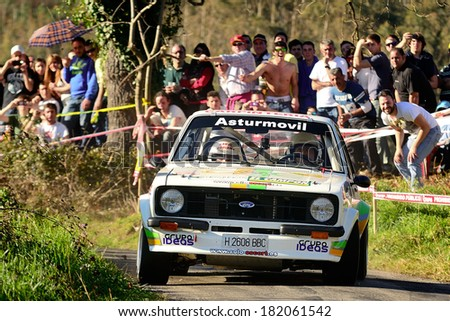 CORNELLANA, SAPIN - MAR 8: Spanish driver Lolo Garcia and his codriver Miguel Rios in a Ford Escort RS2000 Mk II race in the 6th Solo Escort, on Mar 8, 2014 in Asturias, Spain. - stock photo