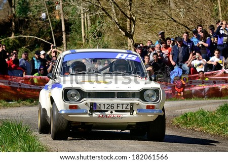 CORNELLANA, SAPIN - MAR 8: Spanish driver Miguel Pindado and his codriver Sergio Garcia in a Ford Escort RS2000 Mk I race in the 6th Solo Escort, on Mar 8, 2014 in Asturias, Spain. - stock photo