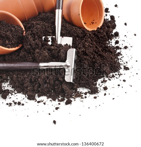 Corner border of gardening tools and seedling in soil surface  isolated on a white background - stock photo