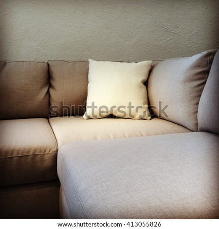 Corner fabric sofa with cushion. Modern furniture.