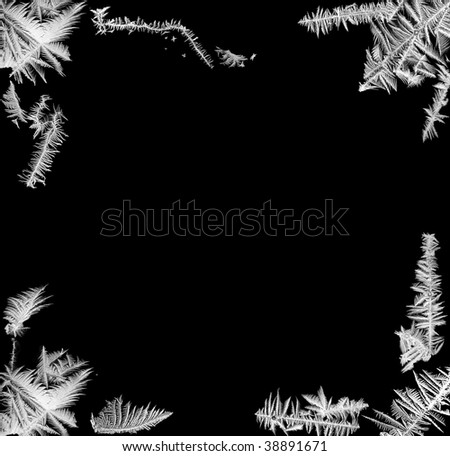 Corner frame made of real frost flowers taken from several windows - stock photo