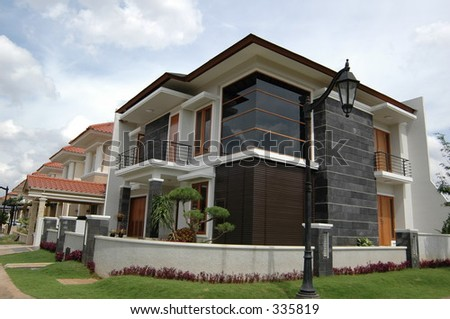 corner house in indonesian real estate complex