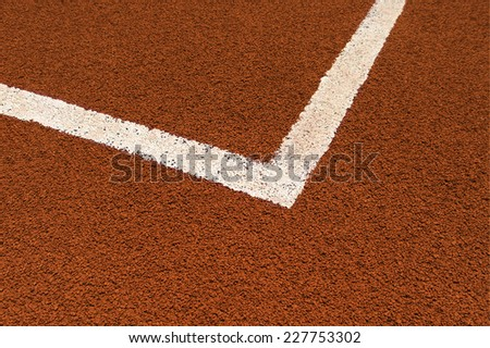 Corner line on a clay tennis court. - stock photo