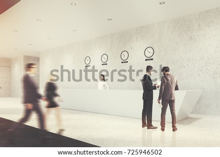 Corner of a long white reception counter standing in an office with concrete walls and a gray floor and a row of clocks showing world time. People. 3d rendering mock up toned image