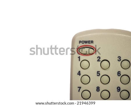 Corner of a remote control on white background.