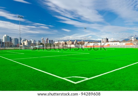 Corner of a soccer field in a bright sunny day. - stock photo