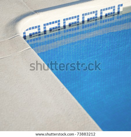 Corner of an outdoor swimming pool on a sunny day