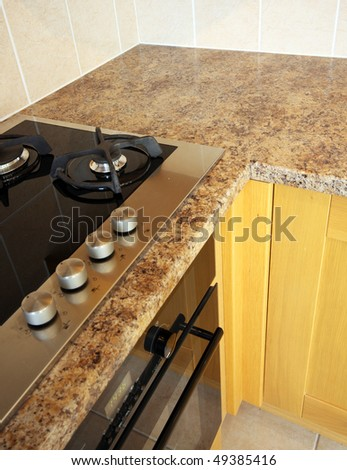 Corner of Beech kitchen units & hob in UK home