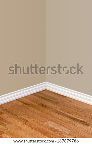 Corner Of Empty Bedroom With View Of Hardwood Floor, Baseboard And Walls