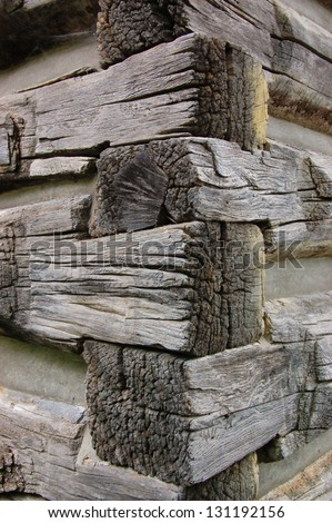corner of pile of old logs or a cabin in the woods, rough wooden texture. Concept for hunting lodge, North American life, Canadian tourism, ecological sustainable material - stock photo