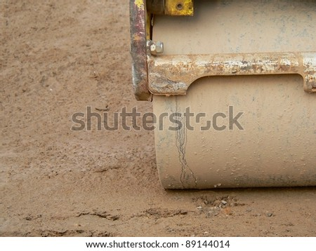 corner of the wheel of a steam roller on a construction site