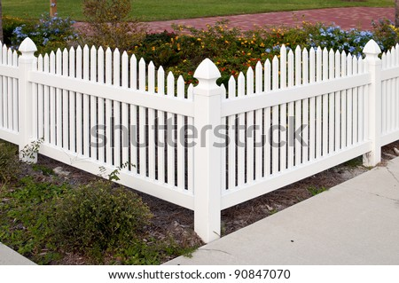 Corner section of a white picket fence