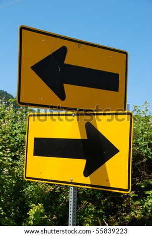 Corner turn marker with arrows going right and left. - stock photo