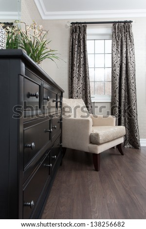 Corner window with a chair - stock photo