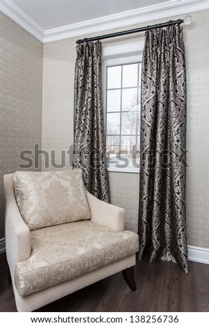 corner window with a chair