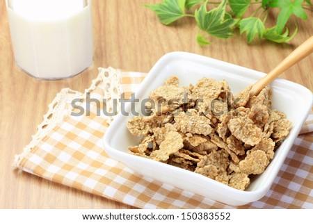 cornflakes and milk - stock photo