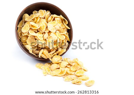 Cornflakes in a wooden bowl isolated on white background. - stock photo