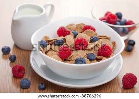 cornflakes with fresh berries - stock photo