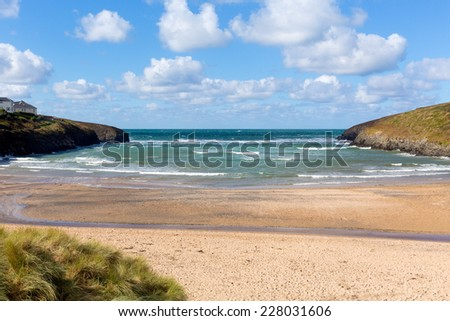 Cornish cove Porthcothan Bay north coast Cornwall England UK between Newquay and Padstow on a sunny blue sky day with hut - stock photo