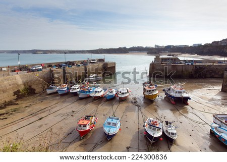 Cornish harbour Newquay North Cornwall England UK with boats at low tide - stock photo