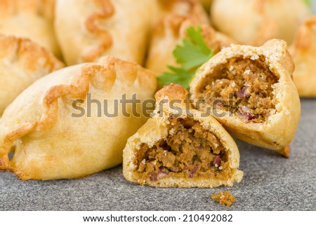 Cornish Pasty - Baked pasty filled with meat and potatoes. Cornwall's traditional dish. - stock photo