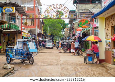 Coron, Philippines - October 10, 2014 : street view of Coron town in Palawan, Philippines. It is the largest town on Busuanga Island - stock photo