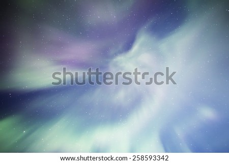 Coronal Aurora with stars from an Alaskan sky. - stock photo