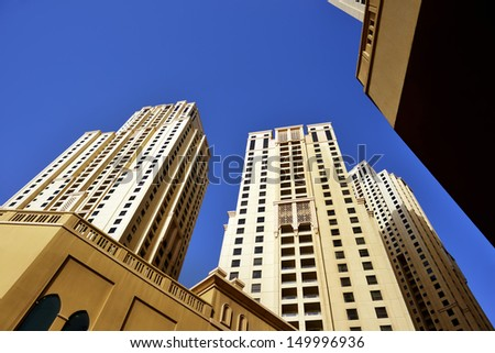 corporate buildings of Dubai, yellow skyline - stock photo