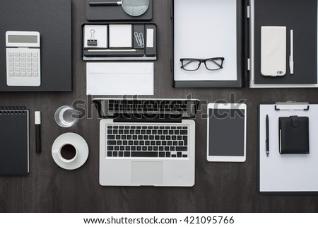 Corporate business desktop with laptop, digital tablet, accessories and work equipment, flat lay banner - stock photo