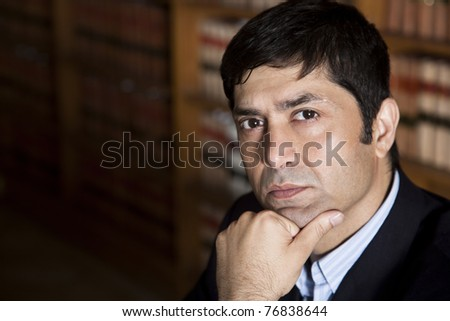 corporate/business lawyer or consultant thinking in the library