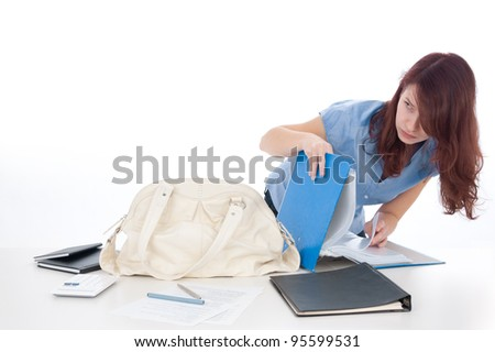 Corporate data leakage and social engineering problem. Woman undercover examine file leaves on office table with secret corporate information.