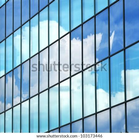 Corporate glass building, sky reflection, city background. - stock photo