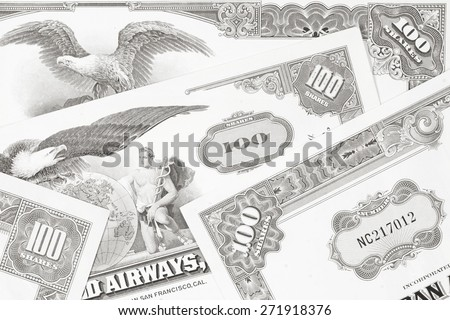 Corporate investing. Old stock share certificates from 1950s-1970s (United States). Vintage scripophily objects. Black and white toned image.