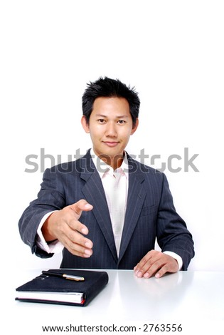 Corporate male showing welcome hand - stock photo