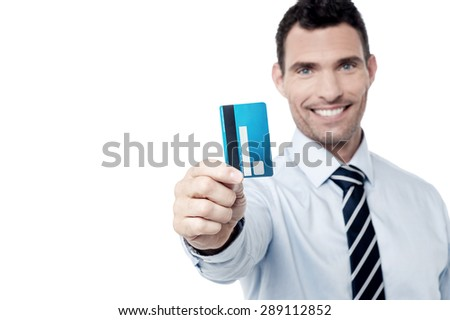 Corporate man showing credit card to camera