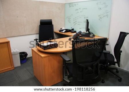 corporate office settings showing desks cubicles files and conference space