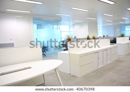Corporate office settings showing desks, cubicles, files, and conference space - stock photo