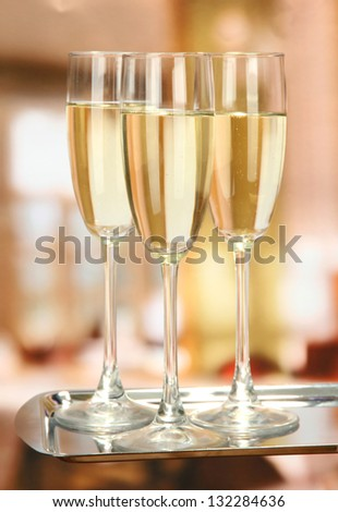 Corporate party: sparkling champagne glasses on tray - stock photo