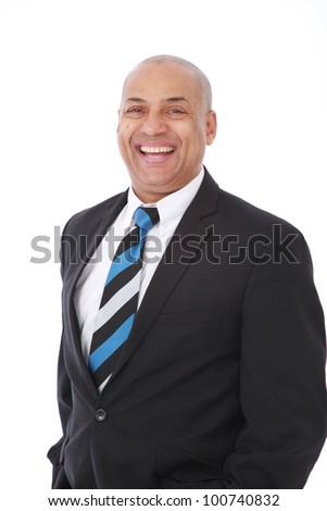 Corporate portrait of a smart intelligent businessman wearing black suit with blue striped tie and smiling - stock photo