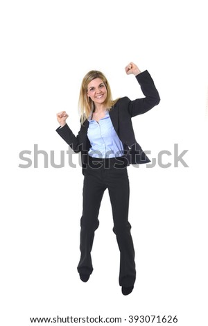 corporate portrait of young attractive and happy business woman with long blond hair posing gesturing with fist excited on career promotion  in female success and successful businesswoman - stock photo