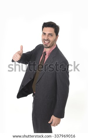 corporate portrait of young attractive businessman of Latin Hispanic ethnicity smiling in suit and tie standing isolated on white background giving thumb up in business success concept - stock photo
