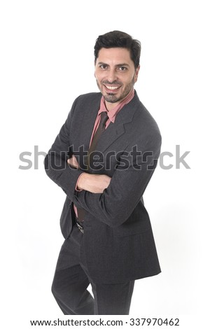 corporate portrait of young attractive businessman of Latin Hispanic ethnicity smiling in suit and tie standing isolated on white background with folded arms