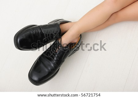 Corporate succession: child with father?s tie and shoes