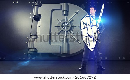 Corporate warrior against digitally generated metallic safe - stock photo